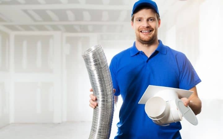 HVAC technician installing HVAC ventilation