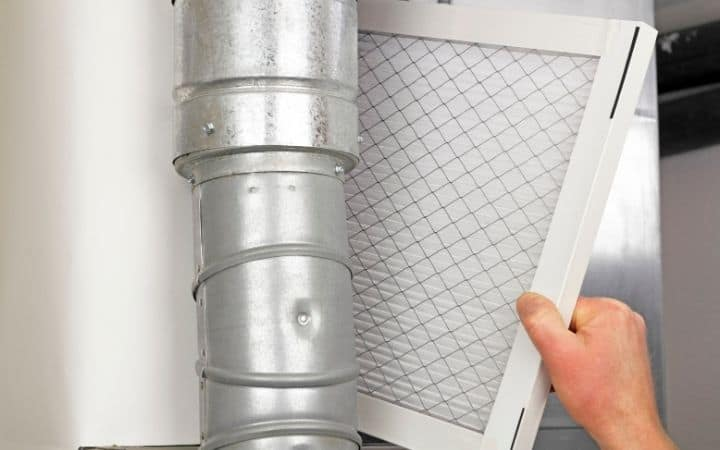 Man Replacing Air Filter