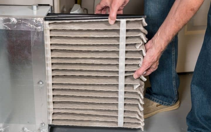 Man changing air filters