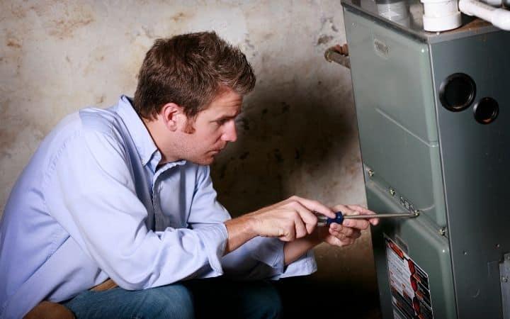 Service man fixing furnace