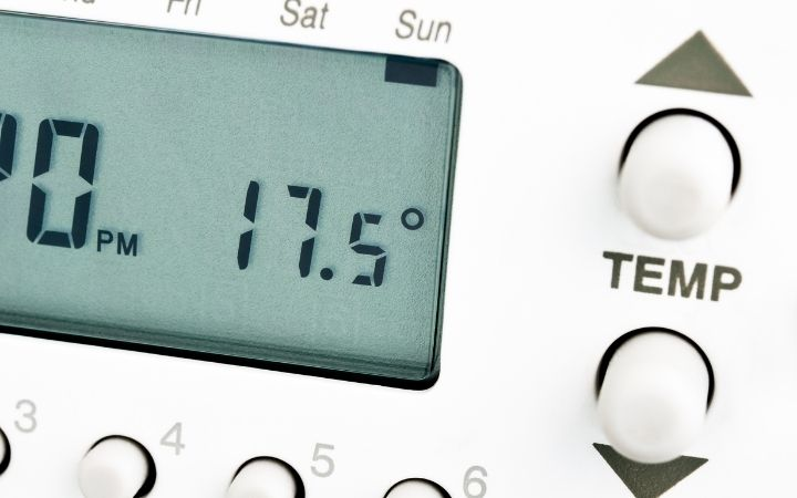 Thermostat showing temperature on display