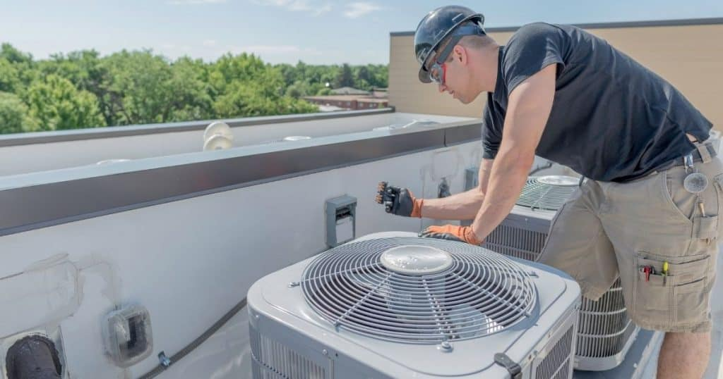 Man installing HVAC unit